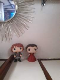 Season 1 Jamie and Season 2 Claire overseeing the activity.